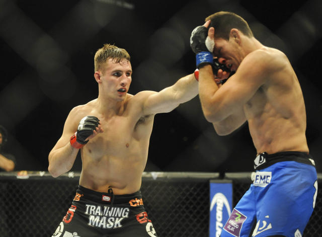 Rory MacDonald impresses with win over Tyron Woodley at UFC 174