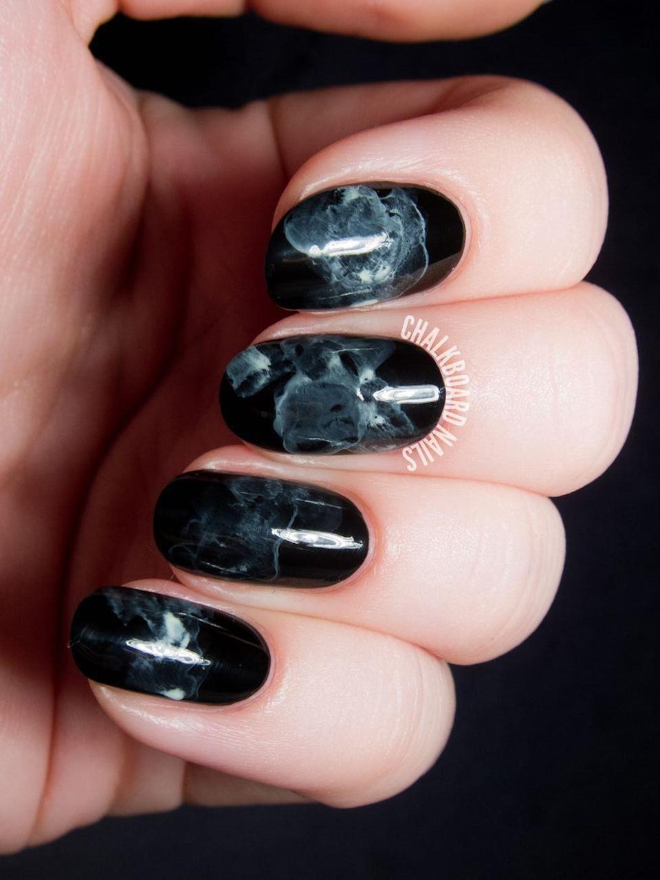 "<p>Glossy, dark, and super mysterious — everyone will be asking where you got your nails done with this eerie manicure. </p><p><em><a href=""http://www.chalkboardnails.com/2014/10/midnight-smoke-nail-art-tutorial.html"" rel=""nofollow noopener"" target=""_blank"" data-ylk=""slk:Get the tutorial at Chalkboard Nails »"" class=""link rapid-noclick-resp"">Get the tutorial at Chalkboard Nails »</a></em></p>"