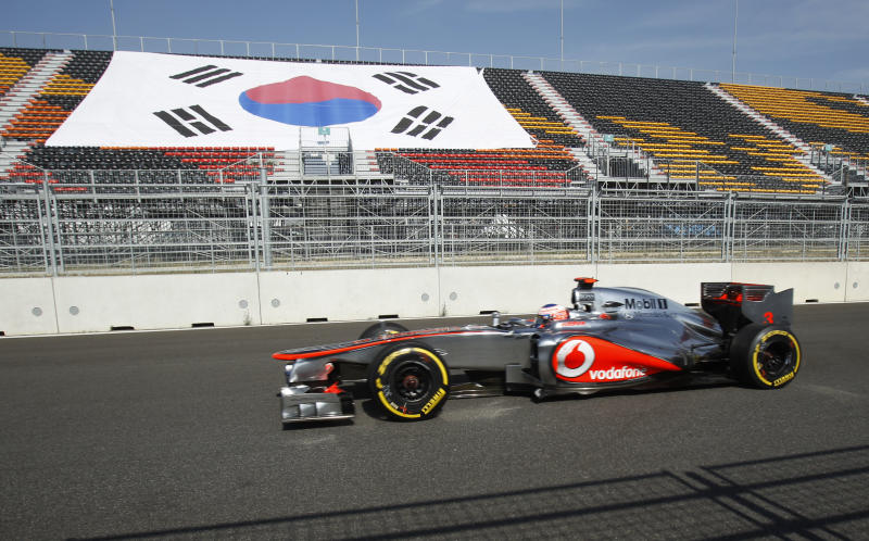 McLaren driver Lewis Hamilton of Britain steers his car during the second practice session for the Korean Formula One Grand Prix at the Korean International Circuit in Yeongam, South Korea, Friday, Oct. 12, 2012. (AP Photo/Wally Santana)