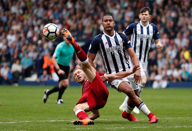 """Soccer Football - Premier League - West Bromwich Albion v Liverpool - The Hawthorns, West Bromwich, Britain - April 21, 2018 West Bromwich Albion's Salomon Rondon fouls Liverpool's Ragnar Klavan Action Images via Reuters/Andrew Boyers EDITORIAL USE ONLY. No use with unauthorized audio, video, data, fixture lists, club/league logos or """"live"""" services. Online in-match use limited to 75 images, no video emulation. No use in betting, games or single club/league/player publications. Please contact your account representative for further details."""