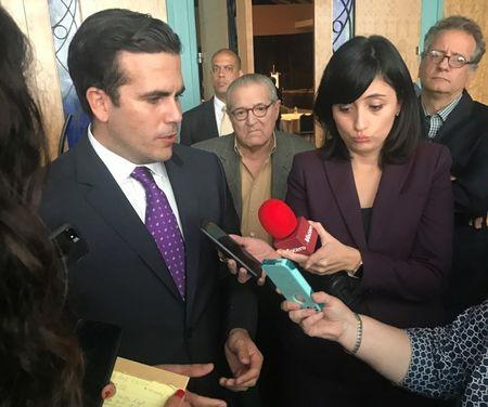 Governor Ricardo Rossello talks with reporters after a speech in San Juan