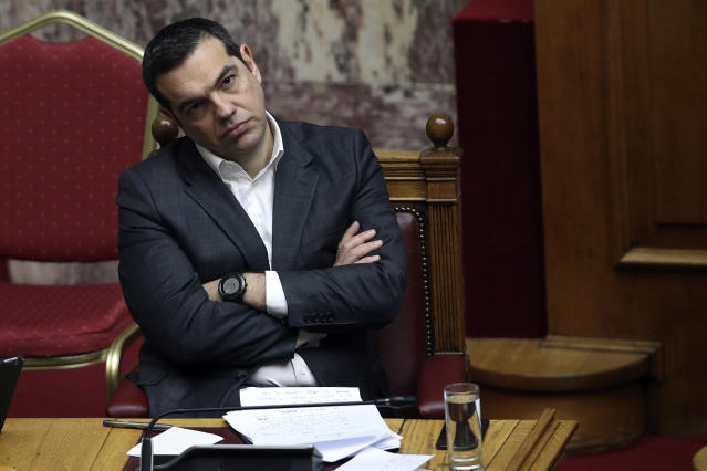 Greek Prime Minister Alexis Tsipras attends a parliamentary session in Athens, on Tuesday, Jan. 15, 2019. Greece's prime minister is defending his deal to normalize relations with neighboring Macedonia ahead of a confidence vote in parliament after his governing coalition collapsed over the agreement. (AP Photo/Petros Giannakouris)