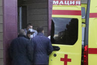 FILE - In this Saturday, Aug. 22, 2020 file photo, Russian dissident Alexei Navalny, not seen in photo, on a stretcher is transferred into an ambulance before being driven to an airport, at the Omsk Ambulance Hospital, in Omsk, Russia. Russian opposition leader Alexei Navalny was the victim of an attack and poisoned with the Soviet-era nerve agent Novichok, the German government said Wednesday, Sept 2, 2020 citing new test results. Navalny, a politician and corruption investigator who is one of Russian President Vladimir Putin's fiercest critics, fell ill on a flight back to Moscow from Siberia on Aug 20 and was taken to a hospital in the Siberian city of Omsk after the plane made an emergency landing. (AP Photo/Evgeniy Sofiychuk, file)