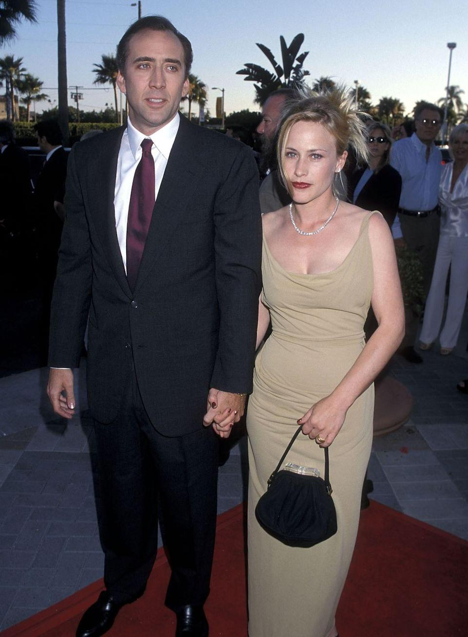 """<p>The action star said """"I do"""" to the Oscar-winning actress back in 1995, following a strange courtship that <a href=""""https://www.independent.co.uk/news/people/profiles/the-thursday-interview-patricia-arquette-624874.html"""" rel=""""nofollow noopener"""" target=""""_blank"""" data-ylk=""""slk:supposedly included"""" class=""""link rapid-noclick-resp"""">supposedly included</a> a proposal from Nicolas the same day they met. After five years, they announced their separation, and the divorce was finalized in 2001.</p>"""