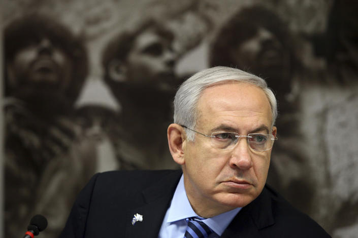 Israeli Prime Minister Benjamin Netanyahu heads a special cabinet meeting marking 'Jerusalem Day' in the Ammunition Hill memorial in Jerusalem, Sunday, May 20, 2012. 'Jeruslem Day' marks the anniversary of Israel's capture of the eastern part of the city in the 1967 Mideast war.(AP Photo/Abir Sultan, Pool)