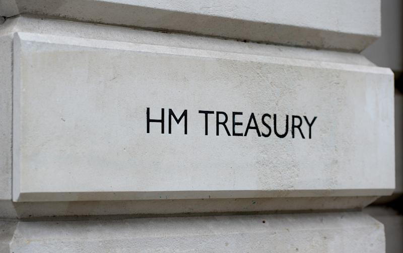 A view of signage for HM Treasury in Westminster, London.