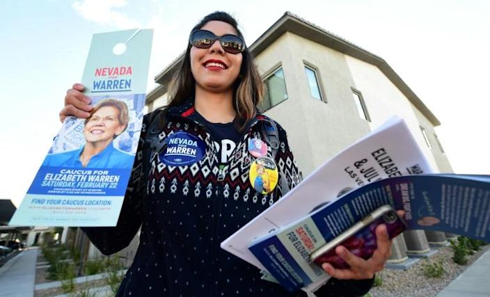 Elizabeth Warren campaign volunteer Ninna Diaz, pictured in Las Vegas on February 21, shows the materials she plans to distribute while knocking on doors of registered Democrats and Independents (AFP Photo/Frederic J. BROWN)