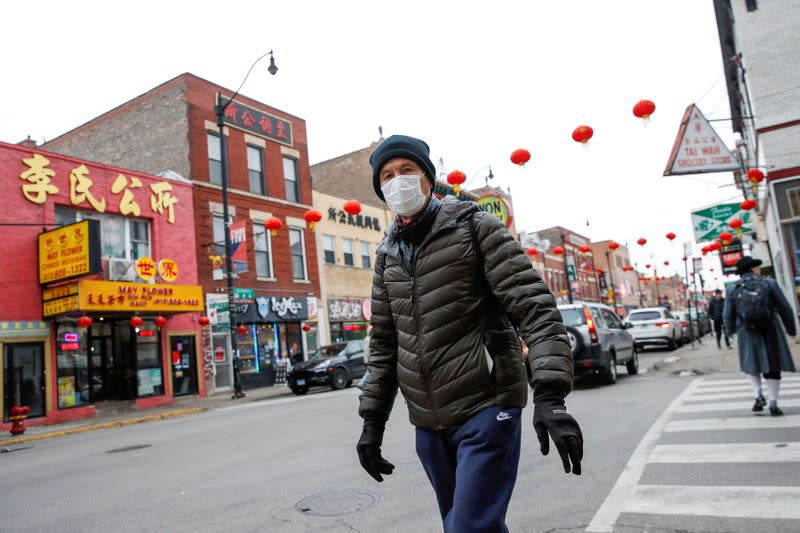FILE PHOTO: A man wears a masks in Chinatown following the outbreak of the novel coronavirus, in Chicago