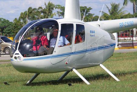 File photo - Then-local mayor of Davao city Rodrigo Duterte (R), aboard a helicopter, arrives at the provincial capitol in Tagum city, Davao del Norte, southern Philippines for the Regional Peace and Order Council meeting, April 20, 2015. REUTERS/Lean Daval Jr.