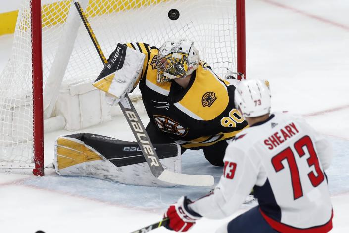 Washington Capitals' Conor Sheary (73) scores against Boston Bruins' Dan Vladar (80) during the first period of an NHL hockey game, Sunday, April 11, 2021, in Boston. (AP Photo/Michael Dwyer)