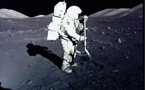 Harrison 'Jack' Schmitt collects lunar rock samples during his 1972 mission to the Moon - Credit: AFP