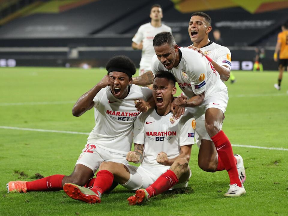 Ocampos and Sevilla celebrate taking lead in Germany: POOL/AFP
