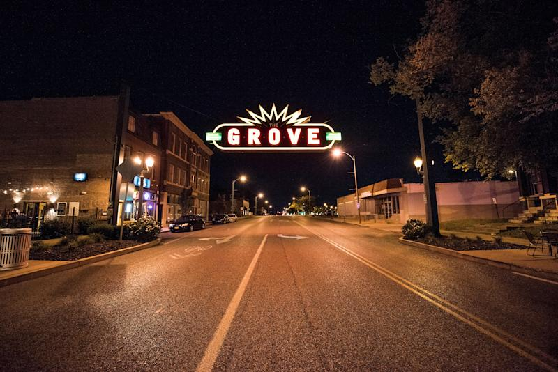 Signs for The Grove business district cast a glow on St. Louis streets.