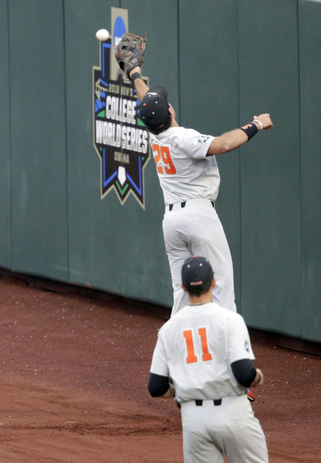 Oregon State center fielder Jack Anderson (29) and right fielder Trevor Larnach (11) chase a ball hit by North Carolina's Kyle Datres during the first inning of an NCAA College World Series baseball elimination game in Omaha, Neb., Wednesday, June 20, 2018. (AP Photo/Nati Harnik)