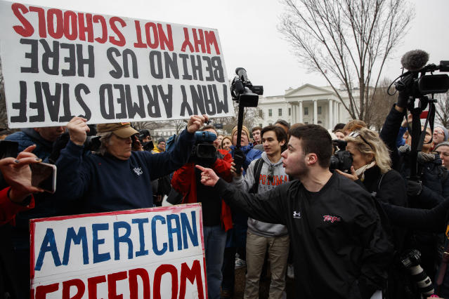 <p>Jackson Baer, 17, of Bethesda, Md., right, argues with Jeff Hulbert of Annapolis, Md., during a protest in favor of gun control reform in front of the White House, Monday, Feb. 19, 2018, in Washington. (Photo: Evan Vucci/AP) </p>