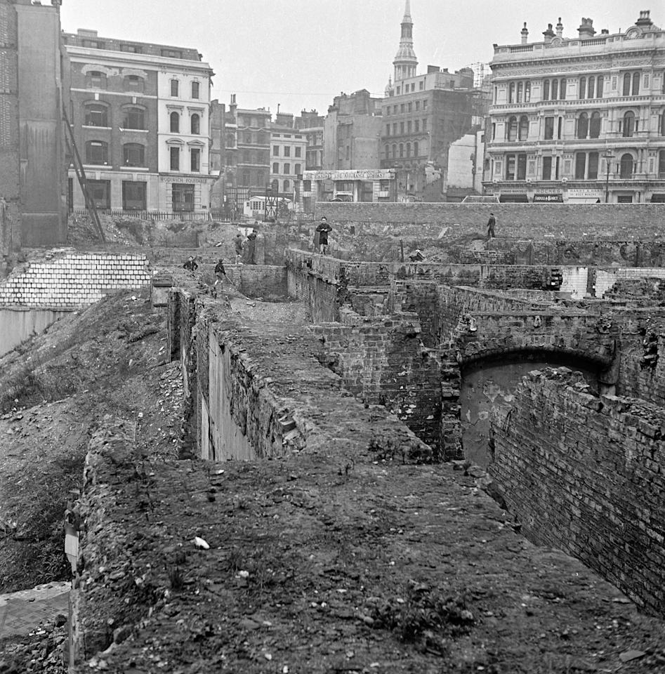 <p>The gaping cellars and foundations of many blitzed sites have not yet been cleared away. The maze of 'caves' and 'hideouts' form an exciting playground for London children who have no other recreation spaces . Mediadrumimages/TopFoto </p>