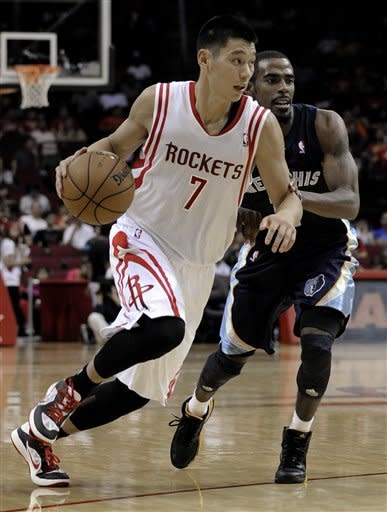 Houston Rockets' Jeremy Lin (7) drives the ball around Memphis Grizzlies' Mike Conley Jr. during the second half of a preseason NBA basketball game Wednesday, Oct. 17, 2012, in Houston. (AP Photo/Pat Sullivan)
