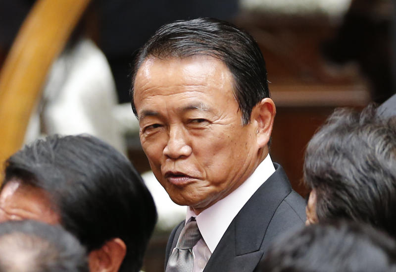 "Japanese Finance Minister Taro Aso smiles as he attends the extraordinary diet session at the Japanese parliament in Tokyo Friday, Aug. 2, 2013. Aso refused Friday to resign or apologize over remarks suggesting Japan should follow the Nazi example of how to change the country's constitution stealthily and without public debate. Following protests by neighboring countries and human rights activists, he ""retracted"" the comments on Thursday but refused to go further. (AP Photo/Koji Sasahara)"