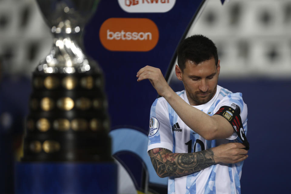 Lionel Messi adjusts his captain's armband before a Group A match between Argentina and Chile at Estadio Olímpico Nilton Santos as part of Copa America Brazil 2021 on June 14, 2021 in Rio de Janeiro, Brazil.
