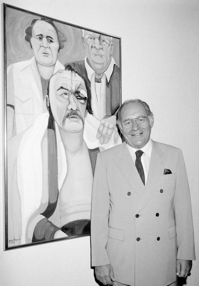 "<p>Ferdie Pacheco (1927-2017): Known as ""The Fight Doctor,"" was cornerman for Muhammad Ali and later served as a boxing analyst. </p>"