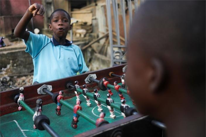 On Tuesday two boys play table football in Ivory Coast's biggest city, Abidjan.