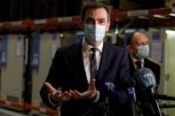 French Health Minister Olivier Veran visits a logistics hub for COVID-19 vaccine distribution in Chanteloup-en-Brie