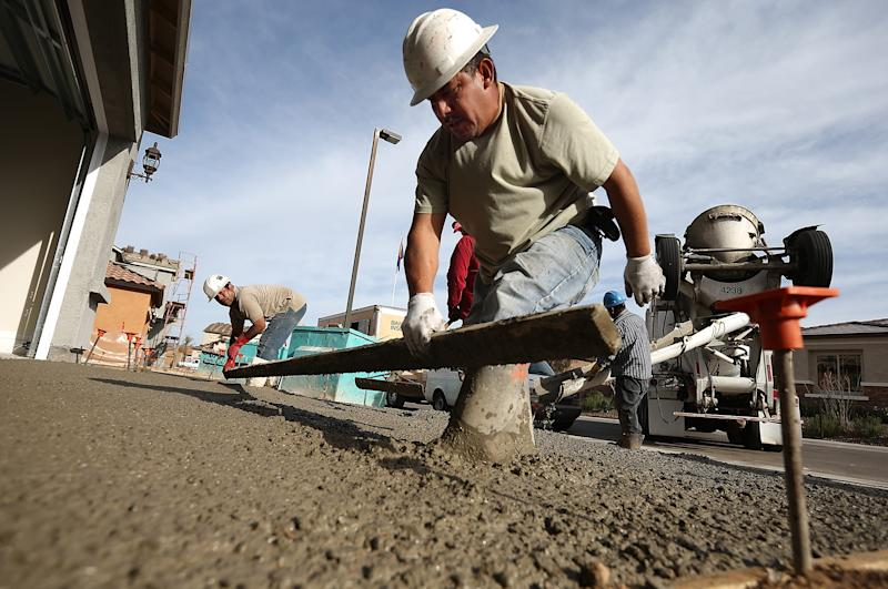PHOENIX, AZ - MARCH 05: Workers pour concrete for a driveway of a new home at the Pulte Homes Fireside at Norterra-Skyline housing development on March 5, 2013 in Phoenix, Arizona. In 2008, Phoenix, Arizona was at the forefront of the U.S. housing crisis with home prices falling 55 percent between 2005 and 2011 leaving many developers to abandon development projects. Phoenix is now undergoing a housing boom as sale prices have surged 22.9 percent, the highest price increase in the nation, and homebuilders are scrambling to buy up land. (Photo by Justin Sullivan/Getty Images)