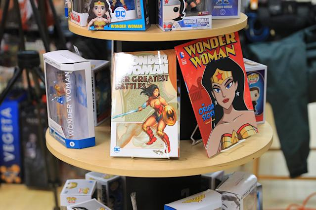 <p>Action figures and book featuring Wonder Woman on display at the Midtown Comics in New York City. (Gordon Donovan/Yahoo News) </p>