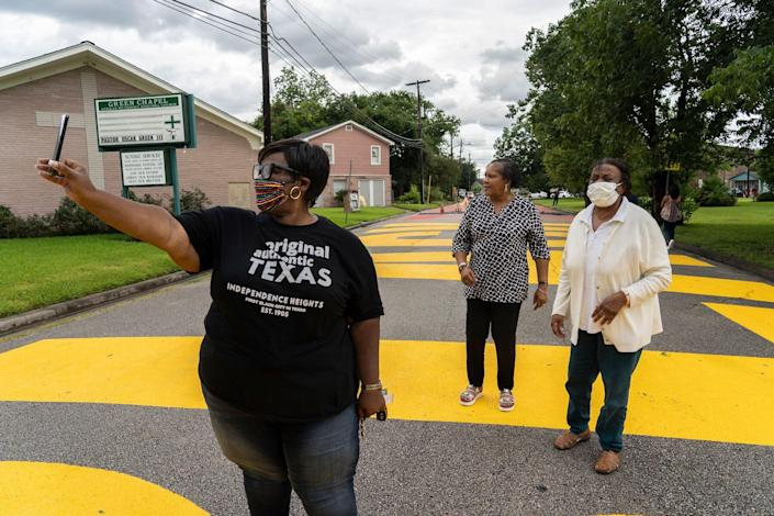 """People come out to see """"Black Towns Matter"""" which is painted on a street on June 19, 2020 in Houston, Texas."""