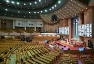Worshippers followed a Christmas service online at the virtually empty Yoido Full Gospel Church in Seoul, which would normally expect 10,000 to attend