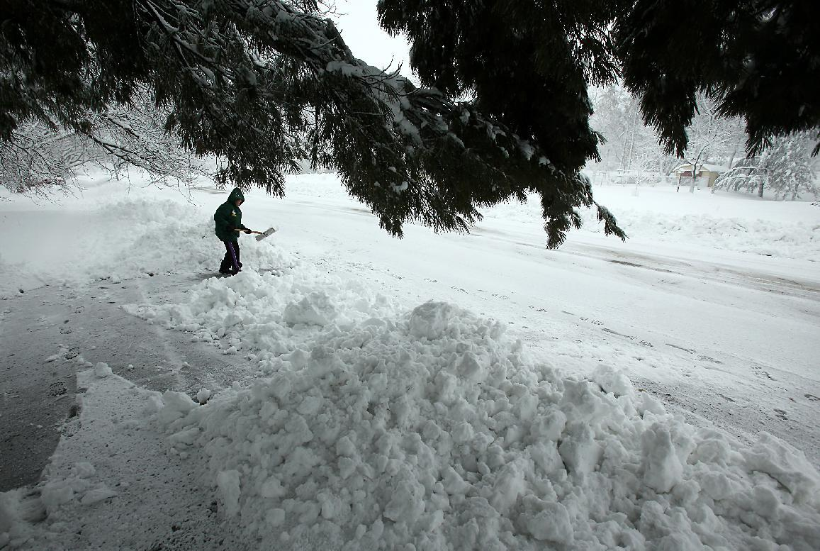 Chris Sauer shovels snow from her driveway during a winter snow storm in Oregon, Wis., Thursday, Dec. 20, 2012. The first major snowstorm of the season began its slow eastward march across the Midwest early Thursday, creating treacherous driving conditions and threatening to disrupt some of the nation's busiest airports ahead of the holiday weekend.(AP Photo/Wisconsin State Journal,Amber Arnold.)