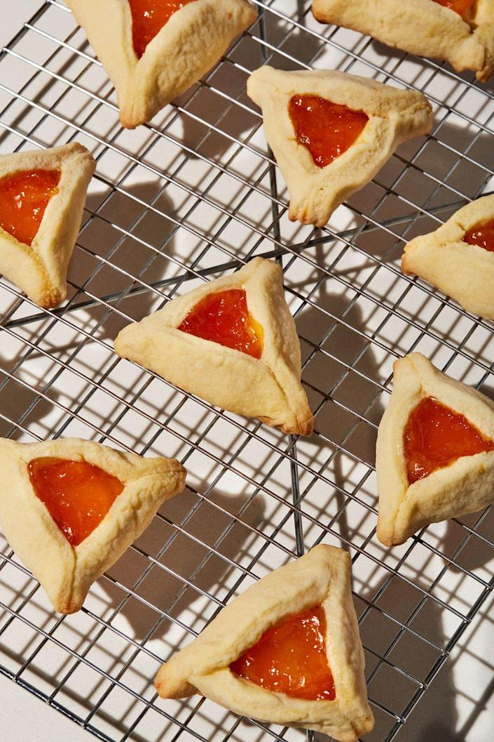 """<p>The prettiest thumbprint cookie EVER is sure to be a hit at your next get-together.</p><p>Get the recipe from <a href=""""https://www.delish.com/cooking/recipe-ideas/a31959676/hamantaschen-recipe/"""" rel=""""nofollow noopener"""" target=""""_blank"""" data-ylk=""""slk:Delish."""" class=""""link rapid-noclick-resp"""">Delish.</a></p>"""