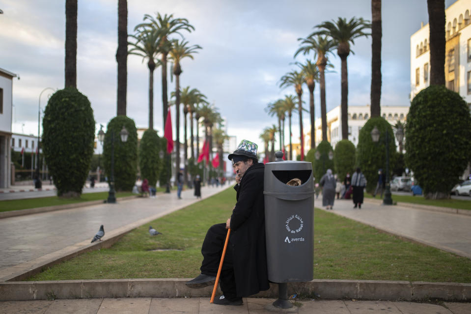 Belhussein Abdelsalam, a Charlie Chaplin impersonator performs in a main avenue in Rabat, Morocco, Thursday, Dec. 17, 2020. When 58-year-old Moroccan Belhussein Abdelsalam was arrested and lost his job three decades ago, he saw Charlie Chaplin on television and in that moment decided upon a new career: impersonating the British actor and silent movie maker remembered for his Little Tramp character. (AP Photo/Mosa'ab Elshamy)