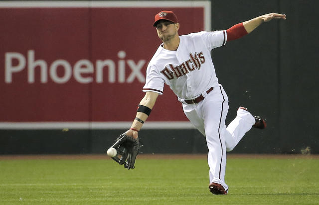 Arizona Diamondbacks' Ender Inciarte can't catch a base hit by Los Angeles Dodgers' Dee Gordon during the fourth inning of a baseball game on Friday, May 16, 2014, in Phoenix. (AP Photo/Matt York)