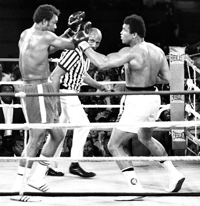 The famous 1974 Rumble in the Jungle between Muhammad Ali (R) and his compatriot and the titleholder George Foreman in Kinshasa. Ali won back his title as world heavyweight boxing champion (AFP Photo/)