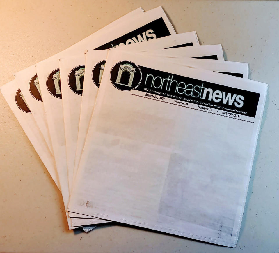 Copies of the March 24, 2021 edition of The Northeast News featuring a blank front page appear in Kansas City, Mo. on March 26, 2021. The paper chose to leave the front page of their March 24 issue blank to show community members what they'd miss if the newspaper folded. (The Northeast News via AP)