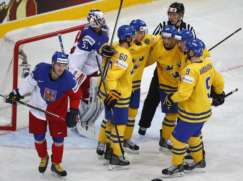 Sweden's players celebrate after Joakim Lindstrom scored against Czech Republic during the bronze medal match between Sweden and the Czech Republic at the Ice Hockey World Championship in Minsk, Belarus, Sunday, May 25, 2014. (AP Photo/Sergei Grits)