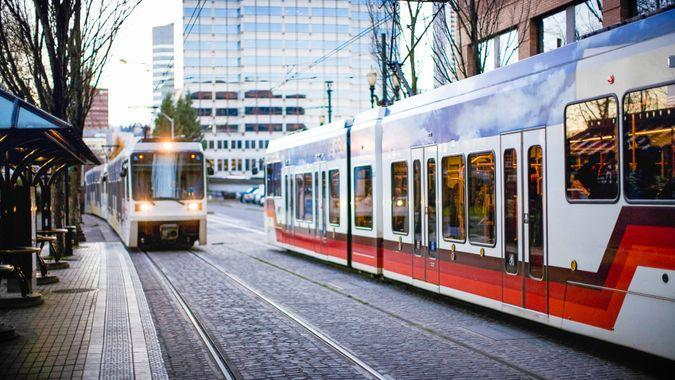 The MAX: Rail train cars coming and going on their tracks in downtown Portland city.