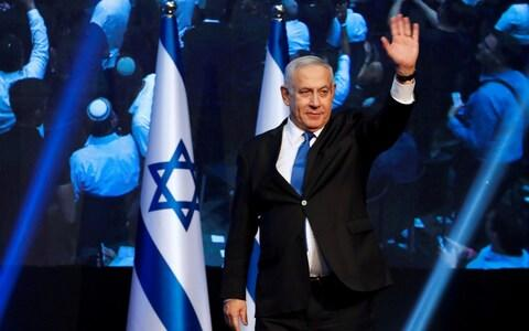 Israeli Prime Minister Benjamin Netanyahu waves to supporters at the Likud party headquarters - Credit: Reuters