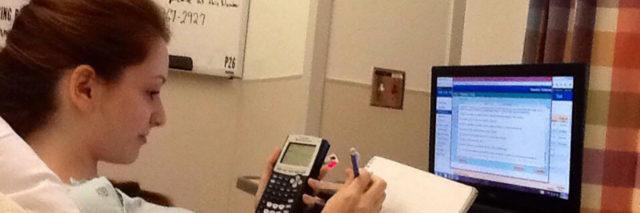 Cassidy doing homework from her hospital bed.