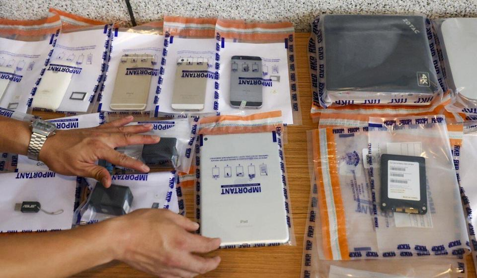 Police display the items seized during the operation. Photo: Nora Tam
