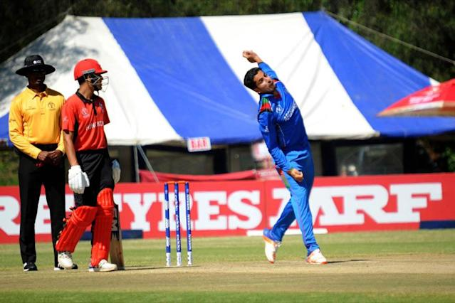 Afghanistan crashed to their third straight World Cup qualifying defeat at the hands of Hong Kong on Thursday, while captain Jason Holder led the West Indies to victory over Papua New Guinea.