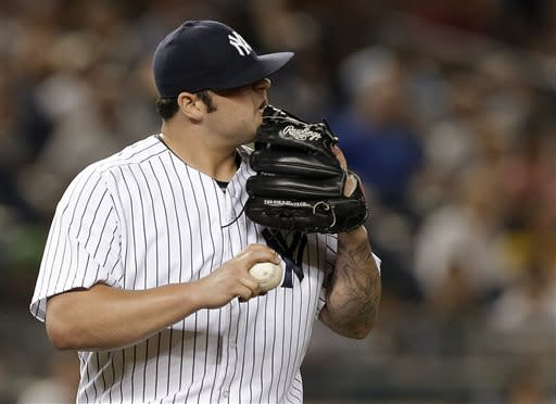 New York Yankees relief pitcher Joba Chamberlain reacts after allowing a seventh-inning, two-run home run to Texas Rangers' Nelson Cruz in a baseball game Wednesday, June 26, 2013, in New York. (AP Photo/Kathy Willens)