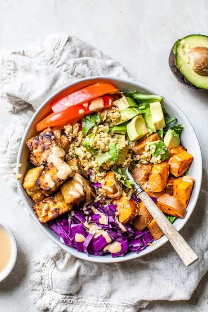 """<p>When it comes to keeping hunger at bay and <a href=""""https://www.womenshealthmag.com/fitness/a28133423/how-to-build-muscle-women/"""" rel=""""nofollow noopener"""" target=""""_blank"""" data-ylk=""""slk:building lean, strong muscles"""" class=""""link rapid-noclick-resp"""">building lean, strong muscles</a>, protein is major. So, if you needed a reminder to eat more high-protein meals, well, consider this it. </p><p>In addition to helping to repair muscle damage after workouts, the stuff also keeps <a href=""""https://www.womenshealthmag.com/weight-loss/a23105426/what-is-metabolism/"""" rel=""""nofollow noopener"""" target=""""_blank"""" data-ylk=""""slk:your metabolism"""" class=""""link rapid-noclick-resp"""">your metabolism</a> revved throughout the day, explains nutritionist <a href=""""https://kellyjonesnutrition.com/"""" rel=""""nofollow noopener"""" target=""""_blank"""" data-ylk=""""slk:Kelly Jones"""" class=""""link rapid-noclick-resp"""">Kelly Jones</a>, RD, CSSD. </p><p>Oh, and it fills you up, too. """"Since protein moves more slowly through the stomach than carbohydrates and fat, it can contribute to feelings of fullness after a meal,"""" says Jones. That's why she always recommends you load up on protein (along with some fat and fiber) at meals to feel more satisfied. </p><p>FYI: Protein is especially important for anyone who regularly hits up bootcamp class or never misses a gym day. Exactly how much YOU need, though, depends. To figure out how much you should eat at each meal, Jones recommends multiplying your weight in pounds by 0.13. For a 130-pound person, that's about 17 grams per meal; for a 200-pound person, that's about 26 grams. (If you don't feel like doing the math, just shoot for somewhere between 15 and 30 grams.)</p><p>And don't worry; getting there is easier than you think. """"You can easily achieve this amount with a four-ounce serving of chicken, two eggs paired with whole-grain toast, or tofu paired with <a href=""""https://www.womenshealthmag.com/food/a23570613/quinoa-health-benefits/"""" rel=""""nofollow noopener"""" target=""""_blank"""" d"""