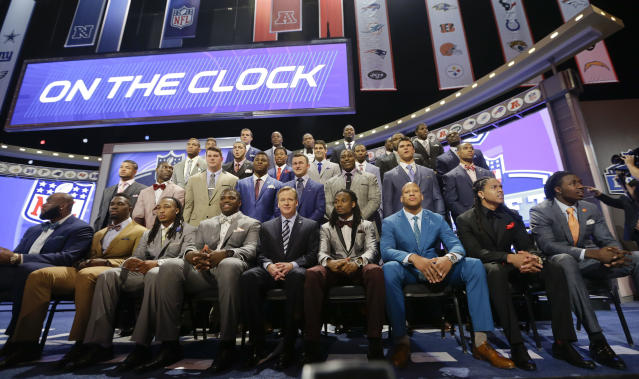 NFL draftees pose with commissioner Roger Goodell at the start of the 2014 NFL Draft, Thursday, May 8, 2014, in New York. (AP Photo/Frank Franklin II)
