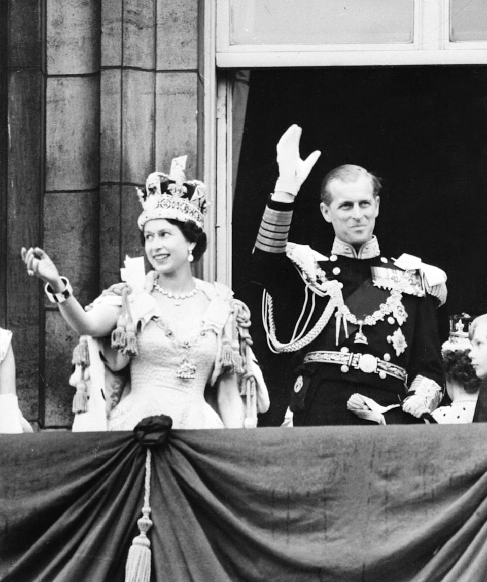 LONDON, UNITED KINGDOM - JUNE 2:  Queen Elizabeth II accompanied by Prince Philip waves to the crowd, 02 June 1953 after being crowned solemnly at Westminter Abbey in London. Elizabeth married the Duke of Edinburgh on the 20th of November 1947 and was proclaimed Queen in 1952 at age 25. Her coronation was the first worldwide televised event.  (Photo credit should read STF/AFP/Getty Images)