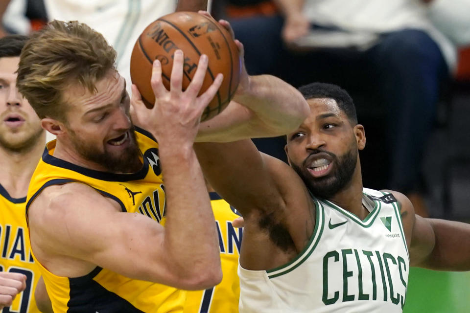 Indiana Pacers forward Domantas Sabonis, front left, rebounds the ball against Boston Celtics forward Tristan Thompson in the second half of an NBA basketball game, Friday, Feb. 26, 2021, in Boston. (AP Photo/Elise Amendola)