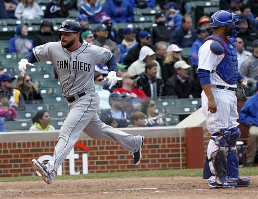 San Diego Padres' Jesus Guzman, left, scores past Chicago Cubs catcher Welington Castillo on a hit by Everth Cabrera during the eighth inning of a baseball game on Thursday, May 2, 2013, in Chicago. (AP Photo/Charles Rex Arbogast)