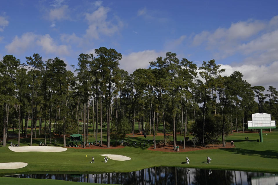 Louis Oosthuizen, of South Africa, Jon Rahm, of Spain, and Bryson DeChambeau walk to the 16th hole during the first round of the Masters golf tournament Thursday, Nov. 12, 2020, in Augusta, Ga. (AP Photo/David J. Phillip)