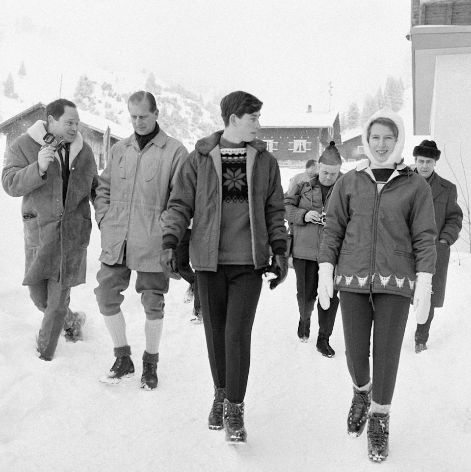 <p>Prince Philip, Prince Charles, and Princess Anne are surrounded by photographers as they take a stroll through the small ski town of Vaduz, Liechtenstein. The royal family was visiting over the New Year in 1965. </p>